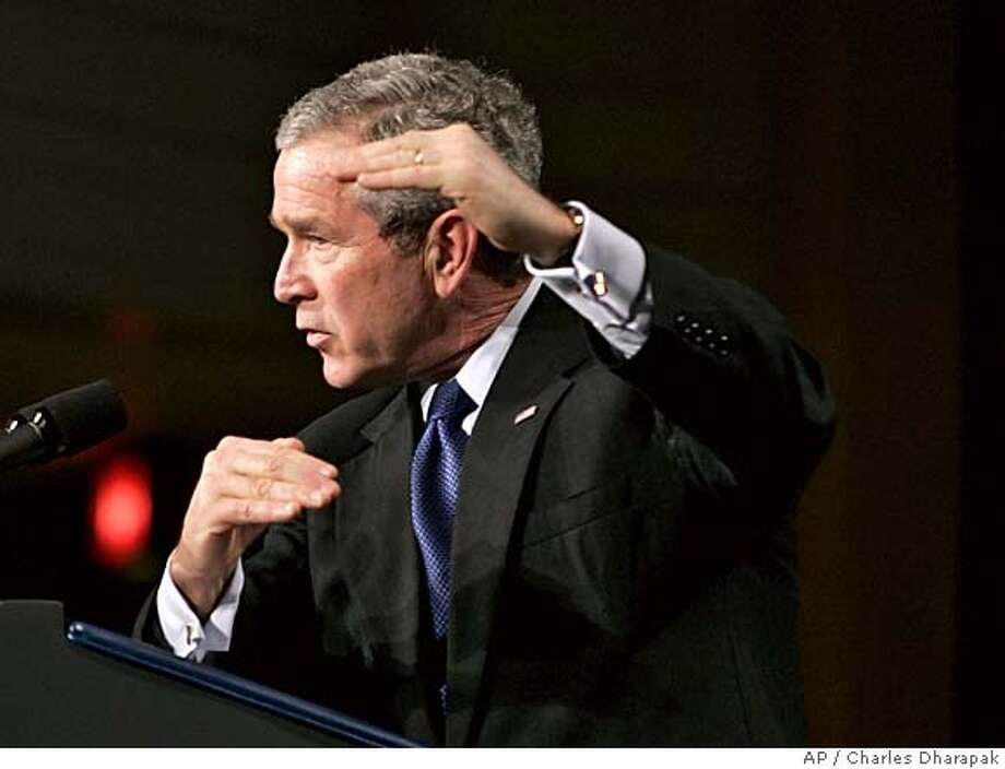 "President Bush gestures as he answers a question from the audience after speaking about the war on terror in Cleveland, Monday, March 20, 2006. President Bush on Monday cited success in stabilizing an insurgent stronghold in northern Iraq, saying he has ""confidence in our strategy"" and critics should look beyond the images of violence to see clear signs of progress. (AP Photo/Charles Dharapak) Photo: CHARLES DHARAPAK"