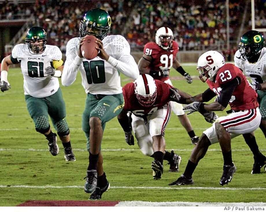 Oregon quarterback Dennis Dixon (10) scores against Stanford in the first quarter of a football game Saturday, Sept. 22, 2007, in Stanford, Calif. (AP Photo/Paul Sakuma) Photo: Paul Sakuma