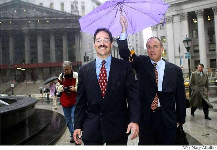 Frank Quattrone, center, leaves federal court in New York with his attorney John Keker, Wednesday, Sept. 8, 2004 after he was sentenced to 18 months in prison plus two years probation after his conviction for obstruction of justice. (AP Photo/Mary Altaffer) Ran on: 09-09-2004  Frank Quattrone (center) leaves federal court in New York with his attorneys Mark Pomerantz (left) and John Keker. Photo: MARY ALTAFFER
