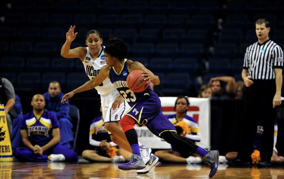 Connecticut's Kaleena Mosqueda-Lewis, back, defends Prairie View A&M's Latia Williams during game action in the 2012 NCAA Women's basketball tournament at Webster Bank Arena at Harbor Yard in Bridgeport, Connecticut, Saturday, March 17, 2012. UConn defeated Prairie View, 83-47. (John Woike/Hartford Courant/MCT) Photo: John Woike, McClatchy-Tribune News Service / Hartford Courant