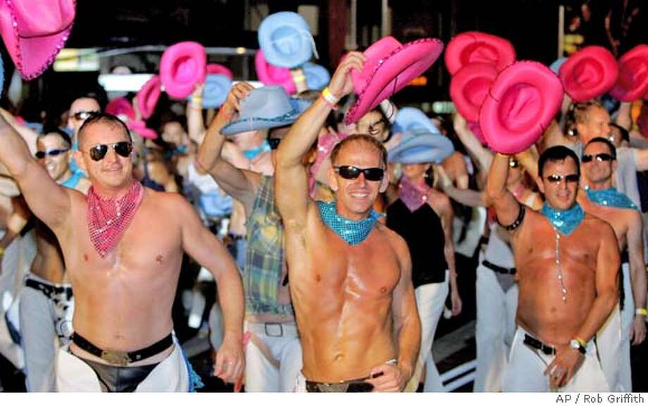 Gay cowboy performers dance during the annual Gay and Lesbian Mardi Gras Parade in Sydney, Australia, Saturday, March 4, 2006.(AP Photo/Rob Griffith) Photo: ROB GRIFFITH