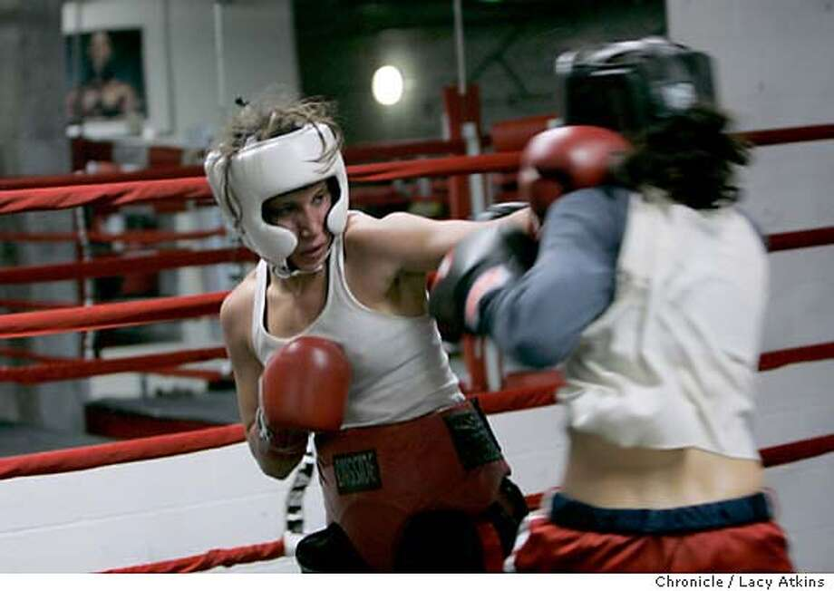 Boxer Cynthia Talmadge, right, spars with Julia Lilly during her workout at the Third Street Boxing Gym, Feb. 22, 2006, in San Francisco. Boxer Cynthia Talmadge, a third generation Portero Hill resident who gave up a career in competitive dancing for a life in the ring, will be competing in San Francisco's Golden Gloves next month. The 23 year old is currently ranked No. 4 in the United States and is the reigning local champion in the 119 lb weight class, Feb. 22, 2006.Photo By Lacy Atkins MANDATORY CREDIT FOR PHOTOG AND SF CHRONICLE/ -MAGS OUT Photo: LACY ATKINS