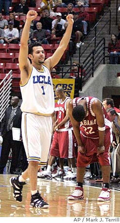 UCLA's Jordan Farmar (1) celebrates UCLA's 62-59 win over Alabama as Alabama's Ronald Steele, right, bends over at the end of the second-round NCAA basketball tournament game Saturday, March 18, 2006, in San Diego. (AP Photo/Mark J. Terrill) EFE OUT Photo: MARK J. TERRILL
