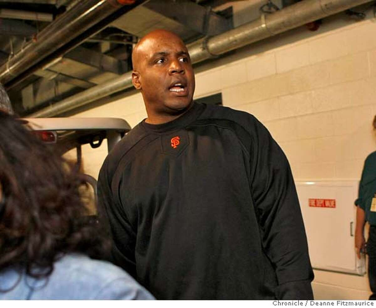 Barry Bonds walks into the locker room before the game on the night it is announced that he will not be back next year as a San Francisco Giants player. Photographed in San Francisco on 9/21/07. Deanne Fitzmaurice / The Chronicle