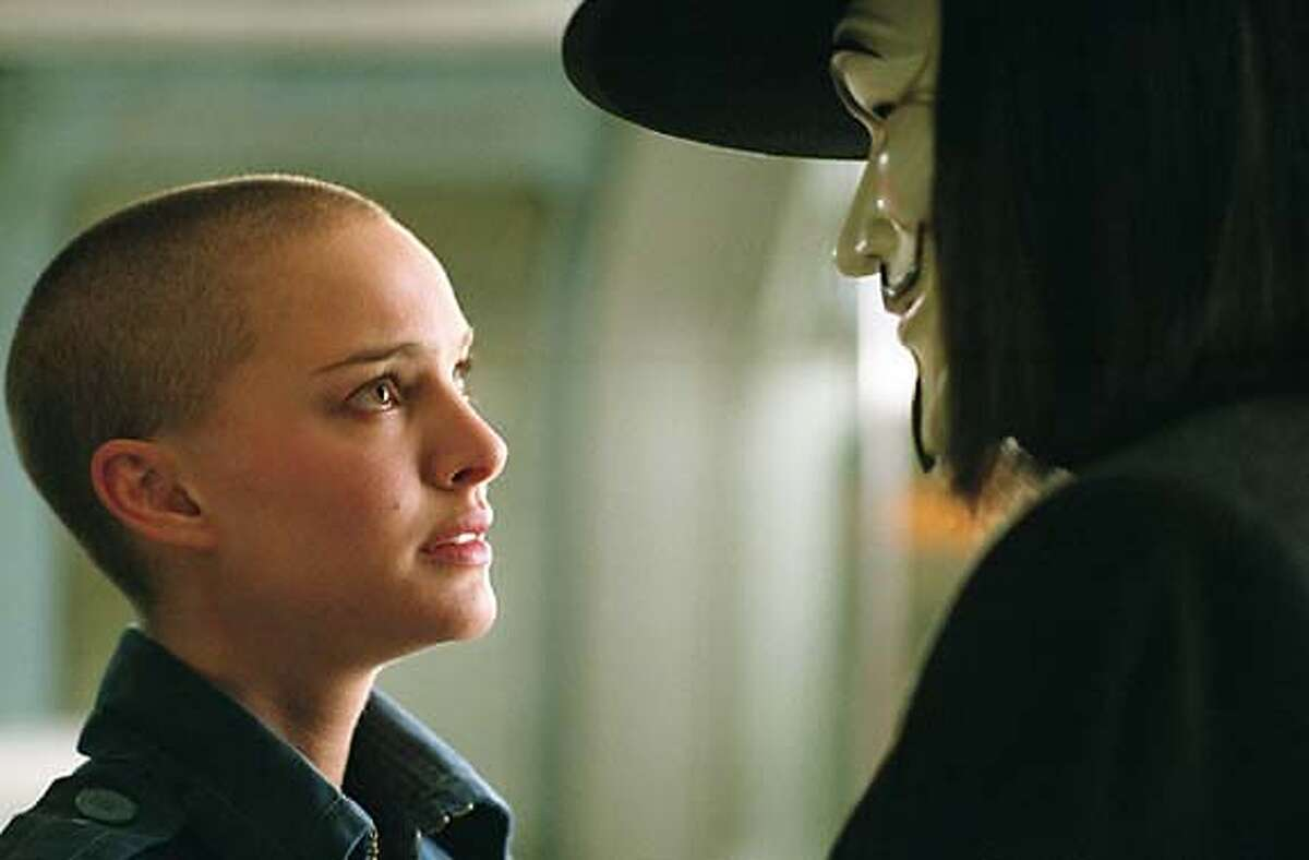 NATALIE PORTMAN as Evey and HUGO WEAVING as V in Warner Bros. Pictures� and Virtual Studios� action thriller �V for Vendetta,� distributed by Warner Bros. Pictures. PHOTOGRAPHS TO BE USED SOLELY FOR ADVERTISING, PROMOTION, PUBLICITY OR REVIEWS OF THIS SPECIFIC MOTION PICTURE AND TO REMAIN THE PROPERTY OF THE STUDIO. NOT FOR SALE OR REDISTRIBUTION.