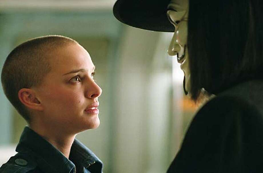 NATALIE PORTMAN as Evey and HUGO WEAVING as V in Warner Bros. Pictures� and Virtual Studios� action thriller �V for Vendetta,� distributed by Warner Bros. Pictures.  PHOTOGRAPHS TO BE USED SOLELY FOR ADVERTISING, PROMOTION, PUBLICITY OR REVIEWS OF THIS SPECIFIC MOTION PICTURE AND TO REMAIN THE PROPERTY OF THE STUDIO. NOT FOR SALE OR REDISTRIBUTION. Photo: Warner Bros.