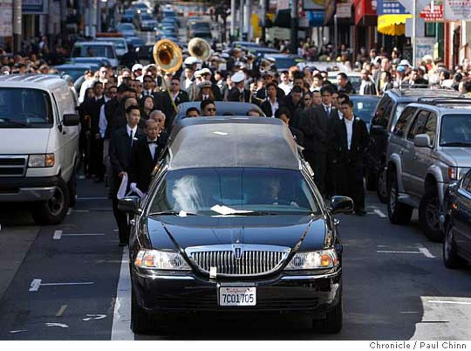 The hearse leads a funeral procession for Allen Leung down Clay Street Chinatown in San Francisco, Calif. on 3/18/06. Leung was killed in his art gallery and framing shop on Jackson Street nearly two weeks ago.  PAUL CHINN/The Chronicle Photo: PAUL CHINN