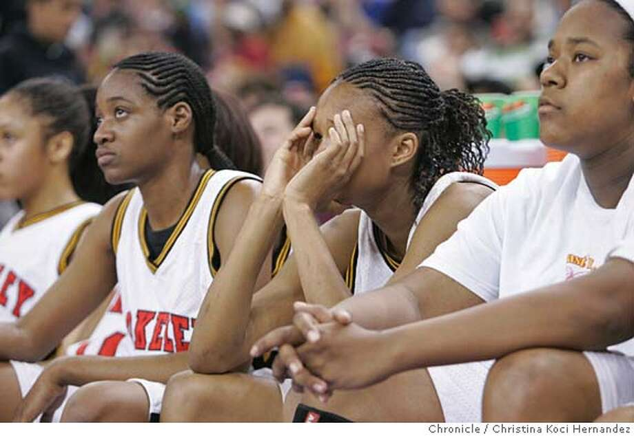 CHRISTINA KOCI HERNANDEZ/CHRONICLE  (L to R) Nnenna Okereke, Jazmine Perkins and Cicley Jones react to their Berkeley team's loss.Berkeley High loses to Long Beach Poly for div. I state championship, 6 pm Photo: CHRISTINA KOCI HERNANDEZ