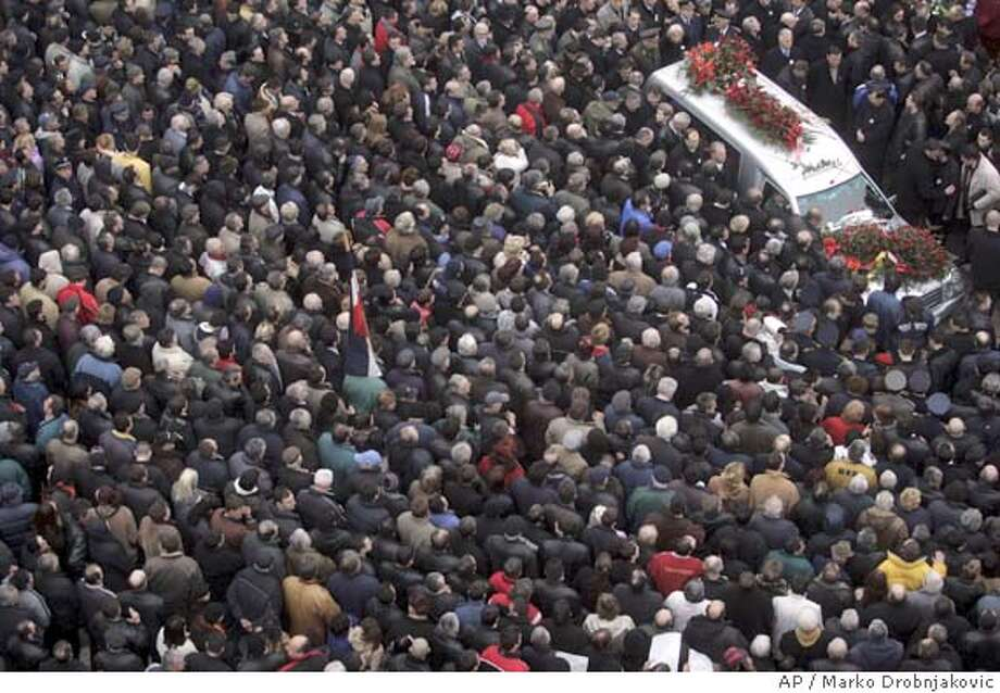 The hearse carrying former Serbian leader Slobodan Milosevic makes its way through the center of his hometown Pozarevac some 50 kilometers (31 miles) south east of Belgrade, Saturday March 18, 2006. Milosevic's remains arrived in his hometown for burial Saturday after a farewell ceremony in Belgrade that drew at least 80,000 admirers in a strong show of nationalism in the Balkan republic.(AP Photo/Marko Drobnjakovic) Photo: MARKO DROBNJAKOVIC