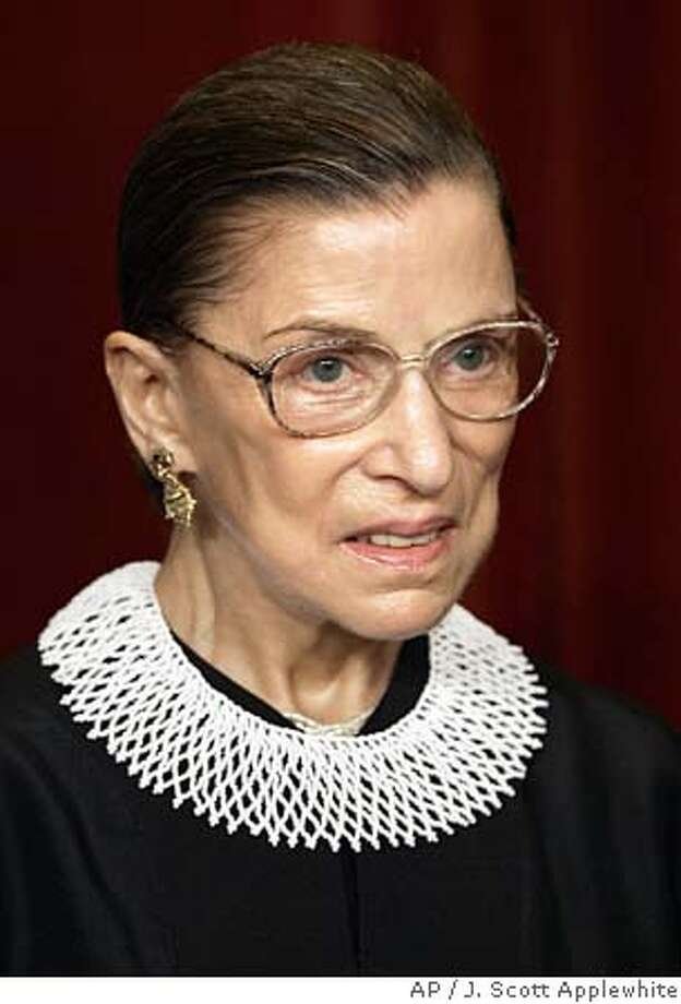 Associate Justice Ruth Bader Ginsburg joins the members of the Supreme Court for photos during a group portrait session, at the Supreme Court Building in Washington, Friday, March 3, 2006.. President Clinton nominated her as an Associate Justice of the Supreme Court, and she took her seat Aug. 10, 1993. (AP Photo/J. Scott Applewhite) Photo: J. SCOTT APPLEWHITE