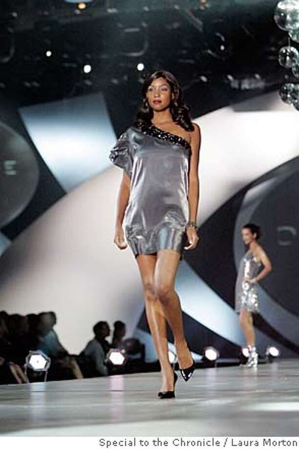 Passport23_0551_LKM.jpg Models walk the runway at Macy's Passport in one of a kind silver dresses that were designed specifically for the show. Macy's Passport celebrated it's 25th anniversary this year. (Laura Morton/Special to the Chronicle) Photo: Laura Morton