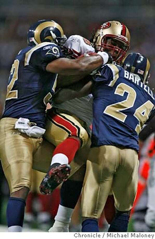 San Francisco 49ers Vernon Davis (#85) is sandwiched between St Louis Rams Brandon Chillar (left)) and St Louis Rams Ron Bartell (#24) in the 1st quarter.  The St Louis Rams host the San Francisco 49ers at Edward Jones Dome on 9/16/07 in St Louis, MO. The SF 49ers won 17-16.  Photo by Michael Maloney / San Francisco Chronicle  ***roster/code replacement MANDATORY CREDIT FOR PHOTOG AND SF CHRONICLE/NO SALES-MAGS OUT Photo: Michael Maloney