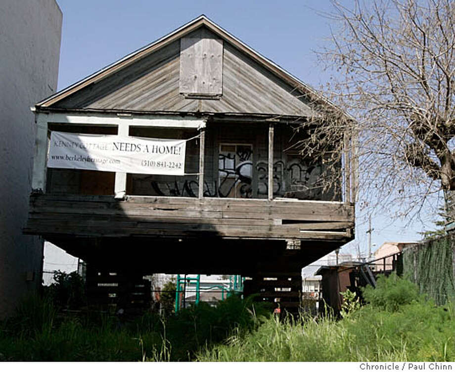 The historic Kenney cottage rests on blocks on an overgrown lot on University Avenue in Berkeley, Calif. on 3/14/06. The Berkeley Architectural Heritage Association is custodian of the cottage after rescuing it from the builder�s demolition ball.  PAUL CHINN/The Chronicle MANDATORY CREDIT FOR PHOTOG AND S.F. CHRONICLE/ - MAGS OUT Photo: PAUL CHINN