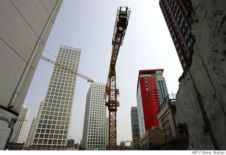A construction site is seen in Beijing Thursday June 14, 2007. The city is in the midst of a building boom as it races to modernize before the Olympic Games in 2008. (AP Photo/Greg Baker)  Ran on: 09-23-2007  Beijing is -- once again -- undergoing an enormous makeover, this one in anticipation of the 2008 Olympic Games. For centuries, rulers have repeatedly remade the Chinese capital to suit their needs. Photo: Greg Baker