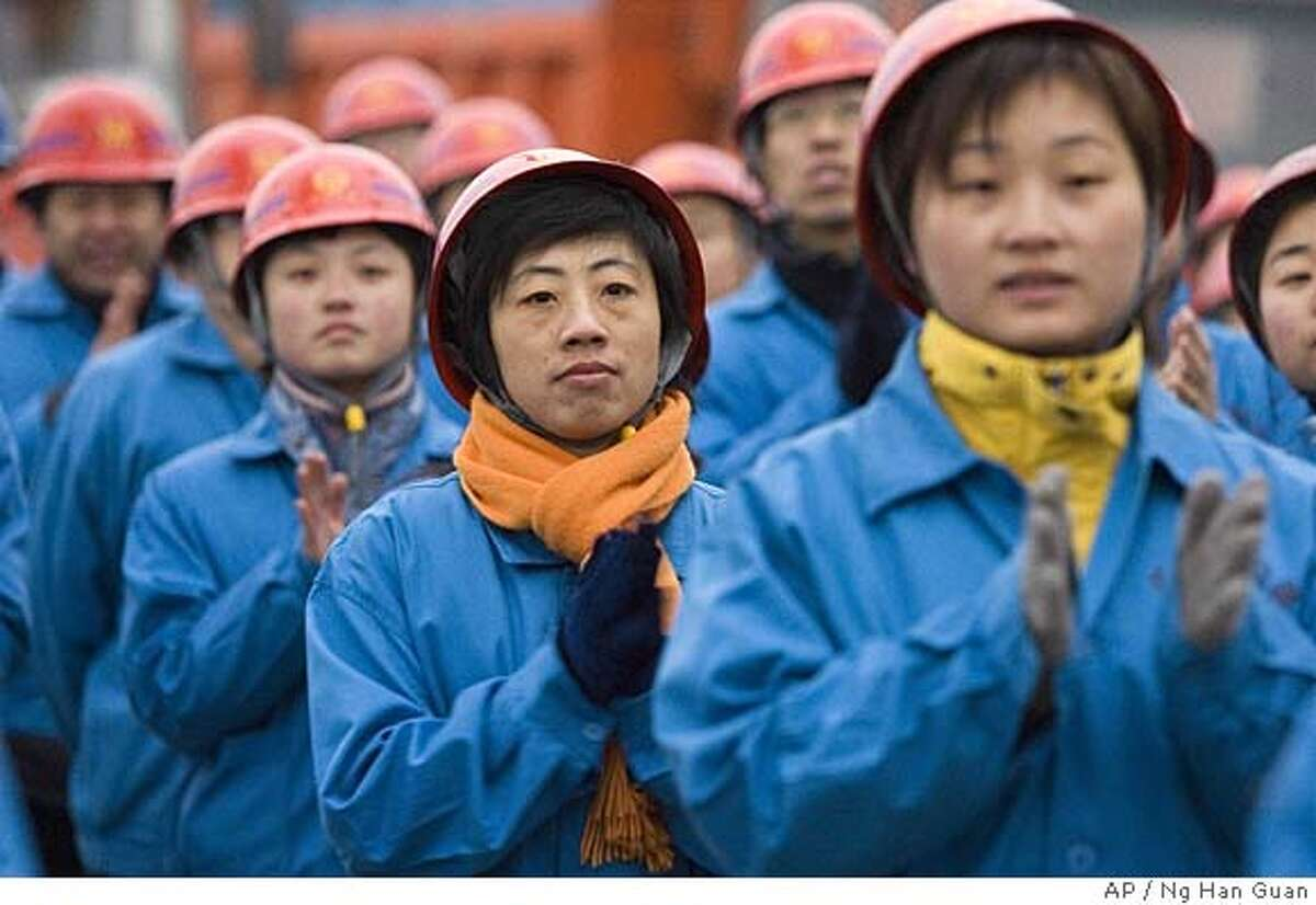 Chinese female construction workers applaud as they attend the groundbreaking ceremony for the Beijing 2008 Olympic Games beach volleyball site in Beijing, China, Wednesday, Dec 28, 2005. The site spans over 15 hectares and will hold 12,000 spectators upon completion in 2007. Beijing is spending billions of dollars to host the 2008 games and is in the midst of building venues and upgrading its infrastructure. (AP Photo/Ng Han Guan) Ran on: 09-23-2007 Beijing is -- once again -- undergoing an enormous makeover, this one in anticipation of the 2008 Olympic Games. For centuries, rulers have repeatedly remade the Chinese capital to suit their needs.
