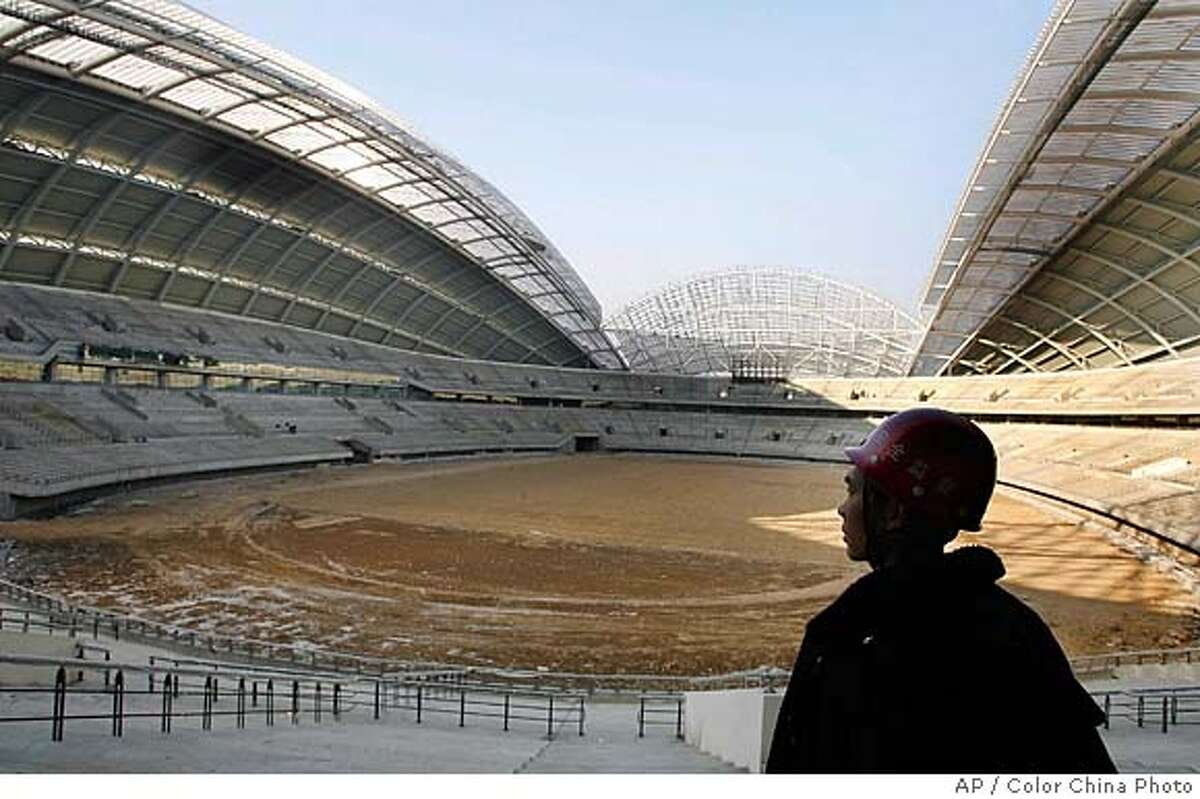 A worker stands in the Shenyang Olympic Sports Center, under construction in Shenyang, in China's northeast Liaoning province Tuesday, Feb. 6, 2007. The center, which is to be completed by June this year, will host soccer matches at the 2008 Olympic Games. (AP Photo/Color China Photo) ** CHINA OUT ** Ran on: 09-23-2007 Beijing is -- once again -- undergoing an enormous makeover, this one in anticipation of the 2008 Olympic Games. For centuries, rulers have repeatedly remade the Chinese capital to suit their needs.