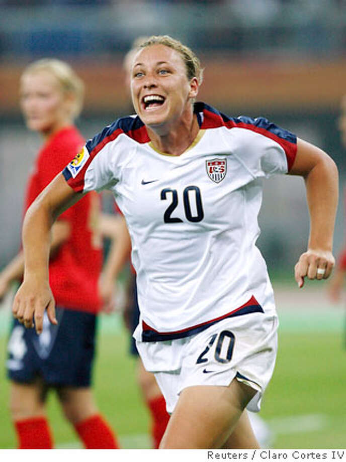 Abby Wambach of the U.S. celebrates a goal past England's players during their quarter-final match in the 2007 FIFA Women's World Cup at Tianjin Olympic Center Stadium in Tianjin September 22, 2007. REUTERS/Claro Cortes IV (CHINA) Photo: CLARO CORTES IV