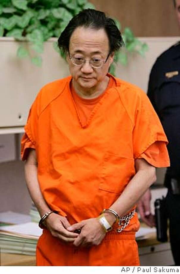 Norman Hsu, 56, is escorted into a Redwood City, Calif., courtorom, Friday, Sept. 21, 2007. Hsu was ordered held without bail Friday, a day after being returned from Colorado on an outstanding warrant for his arrest in a grand theft case. (AP Photo/Paul Sakuma, pool) POOL PHOTO Photo: Paul Sakuma