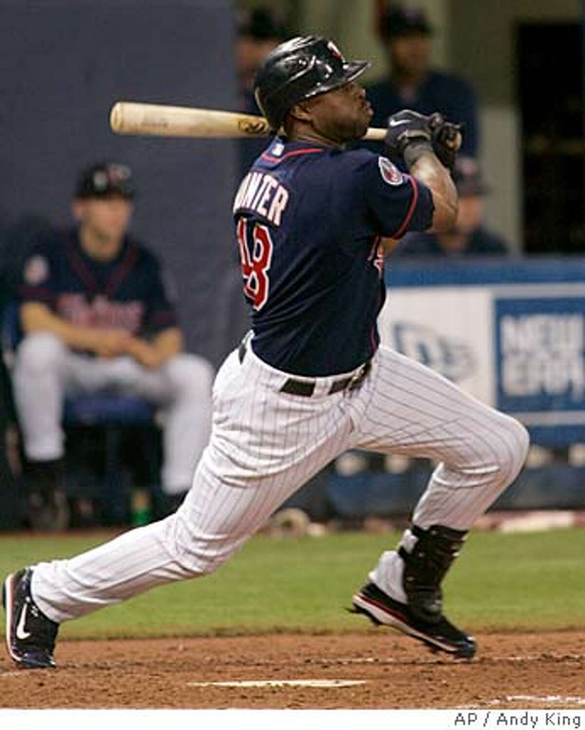 Minnesota Twins' Torii Hunter watches his third inning RBI single during a baseball game against the Texas Rangers in Minneapolis Tuesday, Sept. 18, 2007.(AP Photo/Andy King)