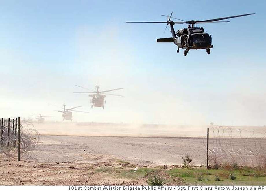 ** RETRANSMISSION TO STATE PHOTOS WERE MADE MARCH 16, 2006** In this handout photo made and released by the U.S. Military on Thursday March 16, 2006, U.S. helicopters take off from a Forward Operating Base Remagen for Operation Swarmer, a combined Iraqi and Coalition operation to clear a suspected insurgent operating area northeast of Samarra, Iraq. U.S. forces Thursday launched what was termed the largest air assault since the U.S.-led invasion, targeting insurgent strongholds north of the capital, the U.S. military said. The American troops were joined by the Iraqi army. (AP Photo/ Sgt. First Class Antony Joseph, 101st Combat Aviation Brigade Public Affairs) Photo: SGT. FIRST CLASS ANTONY JOSEPH