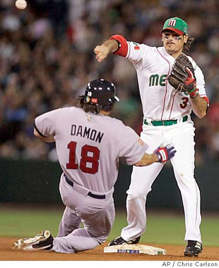 USA's Johnny Damon is forced out at second as Mexico's Jorge Cantu completes the double play to end the game in the second-round of the World Baseball Classic in Anaheim, Calif., on Thursday, March 16, 2006. Mexico won 2-1. (AP Photo/Chris Carlson) Photo: CHRIS CARLSON