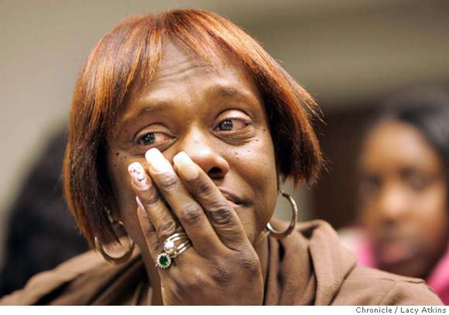 Trina Gary starts to cry as she hears the pastor read off the list donations given in her name, March 8, 2006 at the Great St. John Metropolitan Church in Oakland. Trina gary and her family came to the Bay Area in November after living in temporary shelters following Hurricane Katrina, which destroyed their New Orleans home. They were preparing to return to New Orleans with the help of Gary's $17,090 FEMA relief check. But the day she cashed the check, masked gunmen ambushed the family at their Hayward home and stole the check after putting guns to the heads of Gary and some of her kids. Her son suffered a broken leg trying to escape by jumping out a window. Word of the family's plight sparked an outpouring of support from East Bay residents, who have sent money and cards of sympothy. About $5,000 has been raised and the familly has moved into a new home and bonded with the Oakland church that's leading the fundraising effort. Photo By Lacy Atkins Photo: LACY ATKINS