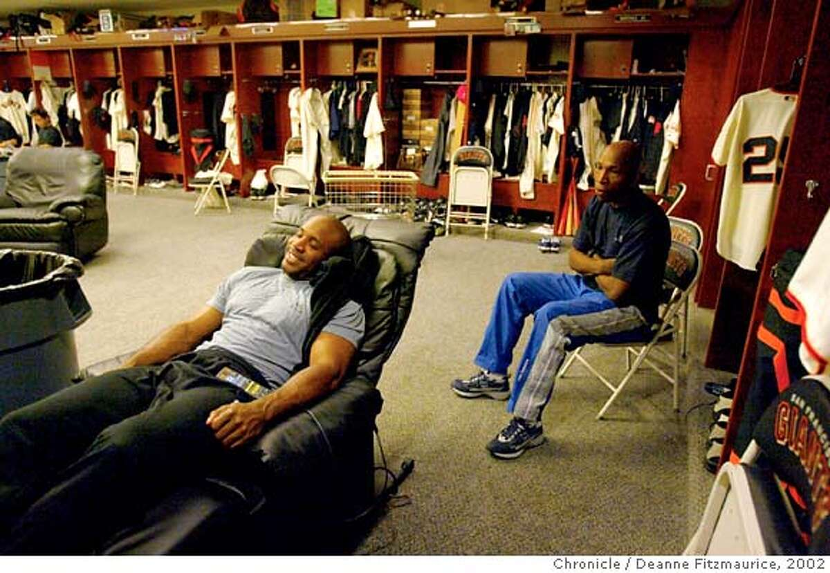 BONDS8-C-05AUG02-SP-DF Barry Bonds relaxes in his reclining chair in the San Francisco Giants clubhouse before a game at Pacific Bell Park. Behind him is one of his trainers, Harvey Shields. Bonds is two homeruns away from 600 career homeruns. CHRONICLE PHOTO BY DEANNE FITZMAURICE Ran on: 01-30-2007 Barry Bonds will be back with the Giants; his personal trainers, Harvey Shields (center) and Greg Oliver, are off the payroll. Ran on: 01-30-2007 Barry Bonds will be back with the Giants; his personal trainers, Harvey Shields (center) and Greg Oliver, are off the payroll. Ran on: 09-23-2007 Barry Bonds got special favors from the time he was hired by the Giants in 1993. Ran on: 09-23-2007 Barry Bonds got special favors from the time he was hired by the Giants for the 1993 season.
