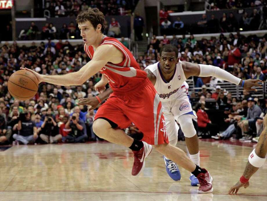 Houston Rockets' Goran Dragic, left, of Slovenia, drives past Los Angeles Clippers' Chris Paul during the second half of their NBA basketball game in Los Angeles, Saturday, March 17, 2012. The Clippers won 95-91. (AP Photo/Jae C. Hong) Photo: Jae C. Hong, Associated Press / AP