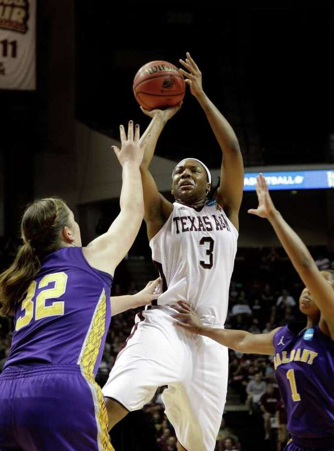 Texas A&M's Kelsey Bone (3) goes up for a shot as Albany's Megan Craig (32) and Cassandra Callaway (1) defend during the first half of an NCAA tournament first-round college basketball game on Saturday, March 17, 2012, in College Station, Texas. Photo: David J. Phillip