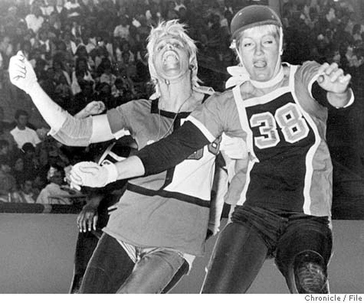 ROLLER DERBY QUEENS ANN CALVELLO, LEFT, AND JOANIE WESTON DUKE IT OUT DURING A 1970S MATCH. CHRON FILE PHOTO CAT