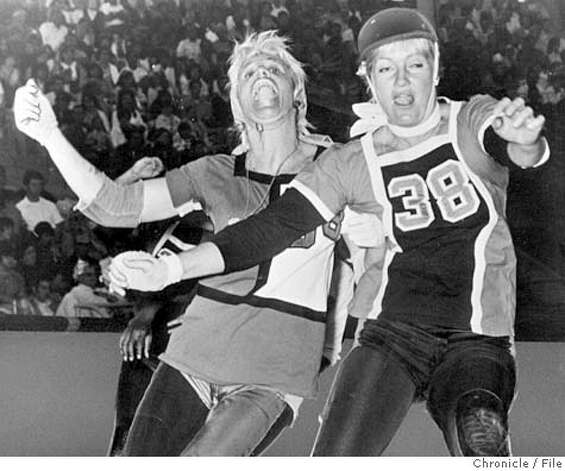 ROLLER DERBY QUEENS ANN CALVELLO, LEFT, AND JOANIE WESTON DUKE IT OUT DURING A 1970S MATCH. CHRON FILE PHOTO CAT Photo: C