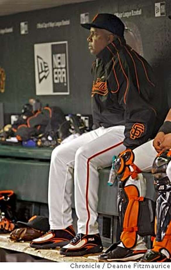 bonds_091_fitzmaurice.jpg  Barry Bonds sits on the bench on the night it is announced that he will not be back next year as a San Francisco Giants player. Photographed in San Francisco on 9/21/07. Deanne Fitzmaurice / The Chronicle Photo: Deanne Fitzmaurice