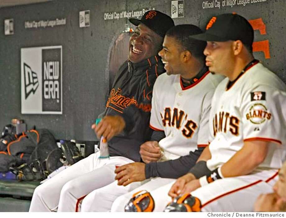 bonds_061_fitzmaurice.jpg  Barry Bonds sits on the bench and laughs with Rajai Davis with Eliezer Alfonzo at right, on the night it is announced that he will not be back next year as a San Francisco Giants player. Photographed in San Francisco on 9/21/07. Deanne Fitzmaurice / The Chronicle Photo: Deanne Fitzmaurice