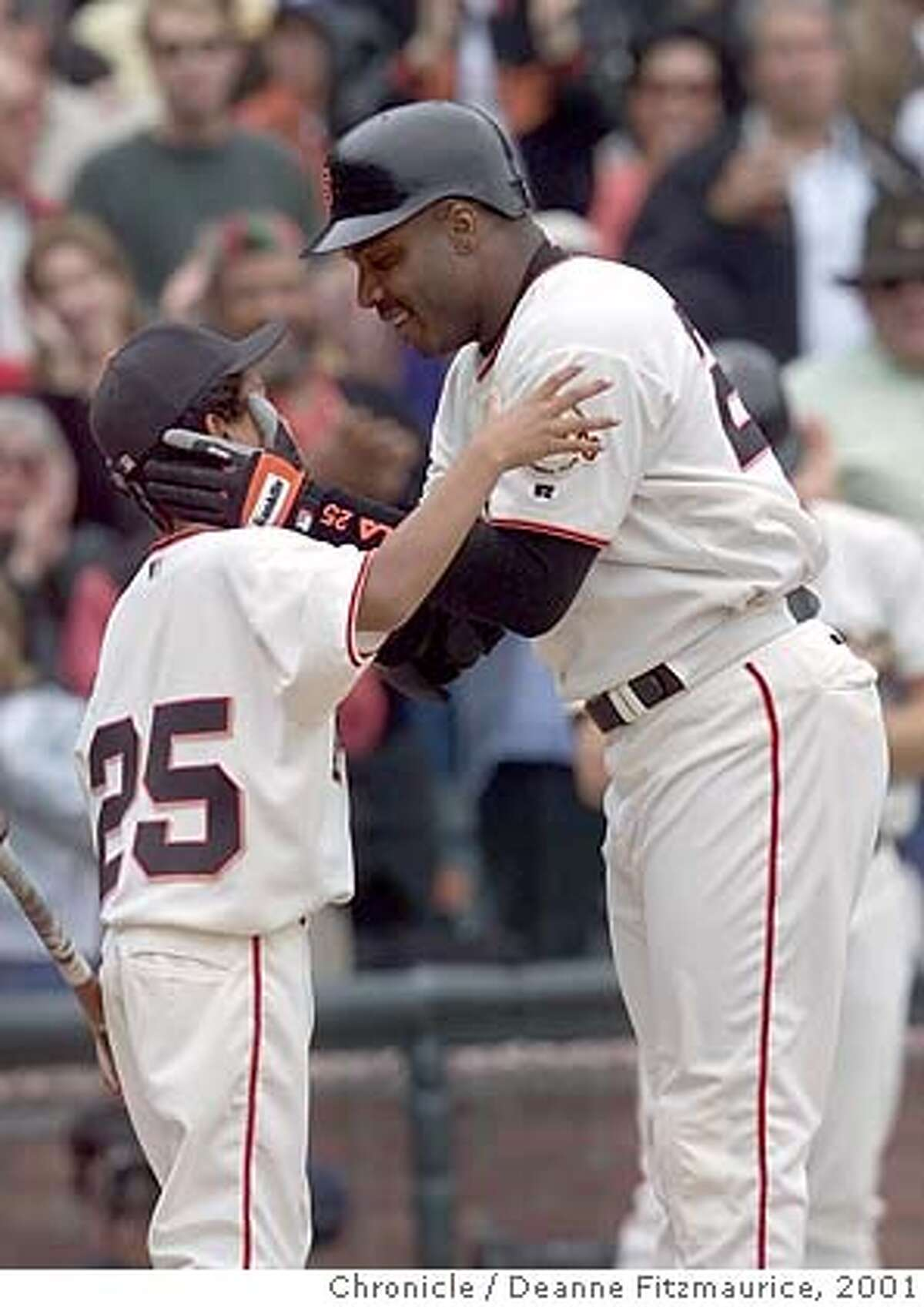 GIANTS1-C-07OCT01-SP-DF Barry Bonds kisses his son Nikolai,11, after crossing the plate with homerun #73 setting a new season record. CHRONICLE PHOTO BY DEANNE FITZMAURICE