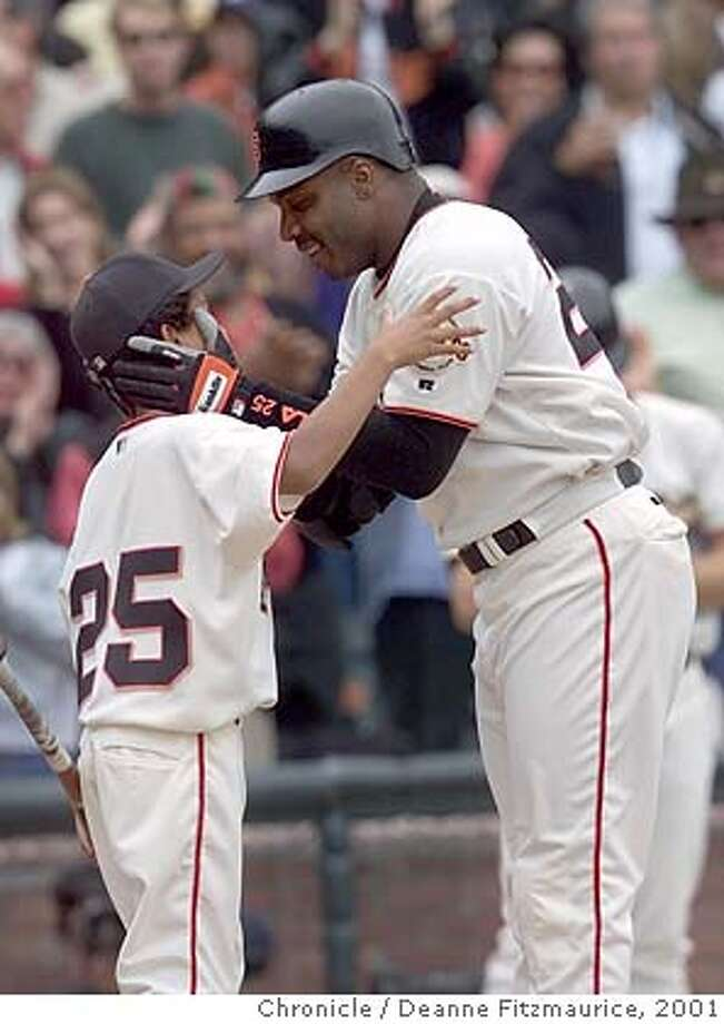 GIANTS1-C-07OCT01-SP-DF Barry Bonds kisses his son Nikolai,11, after crossing the plate with homerun #73 setting a new season record. CHRONICLE PHOTO BY DEANNE FITZMAURICE Photo: DEANNE FITZMAURICE