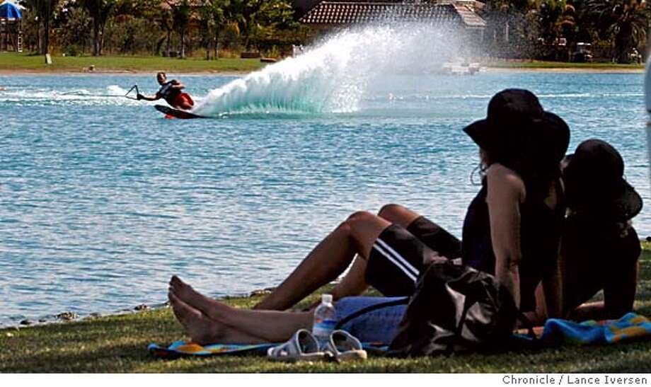 WATER_FEATURE_66905.JPG  Spectators look on as Wayne Abreu from Brentwood rounds a course marker doing 34mph on a 40 ft long ski line. USA Water Ski Assn along with Diablo Shores Water Park are hosting the 2007 Water Ski Pro-Am Tournament this weekend. The event is open to the public at no charge. Saturday 8am-6pm and Sunday 8am-2pm. The event is off Eden Plains road in Brentwood. Sign will guide you into 1024 Petite Sarah Rd. SEPTEMBER 21, 2007. Lance Iversen/The Chronicle (cq) SUBJECT 9/21/07,in BRENTWOOD. CA. ( editors Note, Greg or Debbie Badal 925-997-9914 can give you more info if needed) MANDATORY CREDIT PHOTOG AND SAN FRANCISCO CHRONICLE/NO SALES MAGS OUT Photo: By Lance Iversen