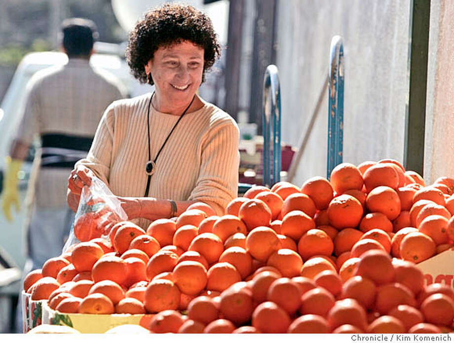 NESTLE15_262_KK.JPG  Marion Nestle shops at Monterey Market in Berkeley.  Marion Nestle, a nationally renowned nutrition/health expert/author, has a new appointment in three departments at UC Berkeley. We photograph her in class and catch her at Berkeley's Monterey Market.  San Francisco Chronicle photo by Kim Komenich  2/24/06 � Copyright 2006 Kim Komenich/San Francisco Chronicle Photo: Kim Komenich