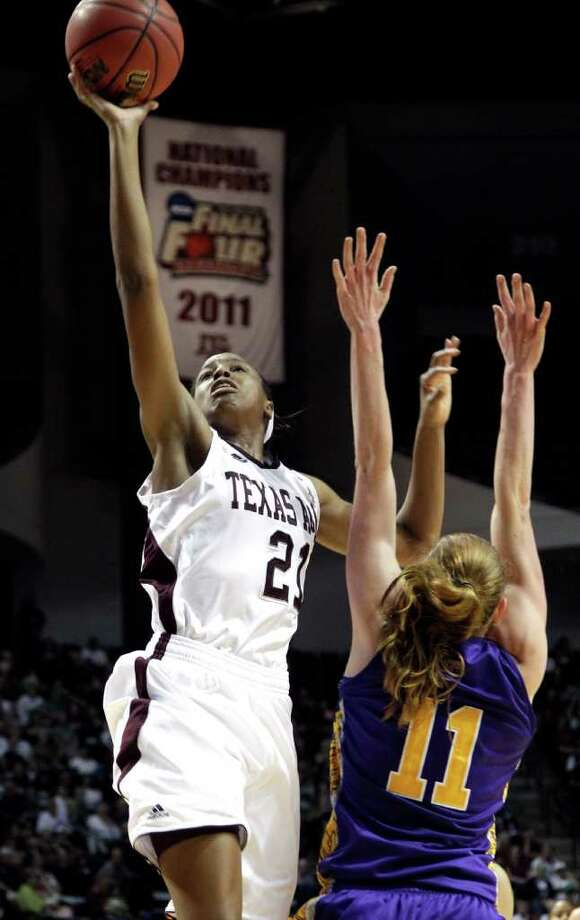 Texas A&M's Adaora Elonu (21) shoots over Albany's Julie Forster (11) during the first half of an NCAA tournament first-round college basketball game on Saturday, March 17, 2012, in College Station, Texas. (AP Photo/David J. Phillip) Photo: David J. Phillip