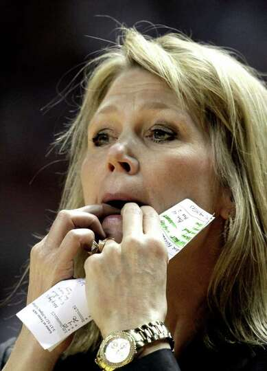 Albany coach Katie Abrahamson-Henderson whistles to her players during the first half of an NCAA tou