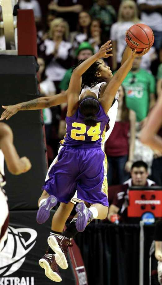 Albany's Adrienne Jones (24) has her shot blocked by Texas A&M's Tyra White during the first half of an NCAA tournament first-round college basketball game on Saturday, March 17, 2012, in College Station, Texas. (AP Photo/David J. Phillip) Photo: David J. Phillip