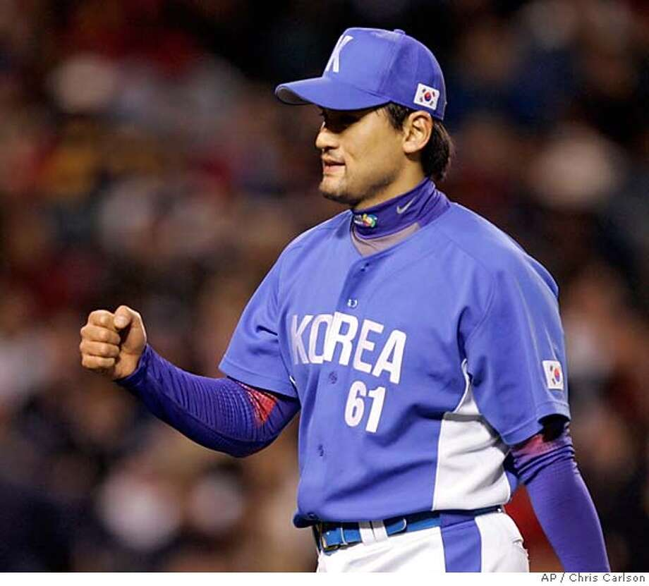 South Korea's starting pitcher Chan Ho Park pumps his fist after leaving the field at the end of the first inning against Japan in the second-round of the World Baseball Classic in Anaheim, Calif., on Wednesday, March 15, 2006. (AP Photo/Chris Carlson) Photo: CHRIS CARLSON