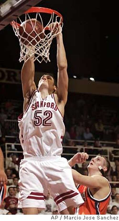 Stanford's Matt Haryasz, left, dunks as Virginia's Laurynas Mikalauskas, right, looks in the first half of a NIT college basketball game in Stanford, Calif. on Tuesday March 14, 2006. Stanford won 65-49. (AP Photo/Marcio Jose Sanchez) Photo: MARCIO JOSE SANCHEZ