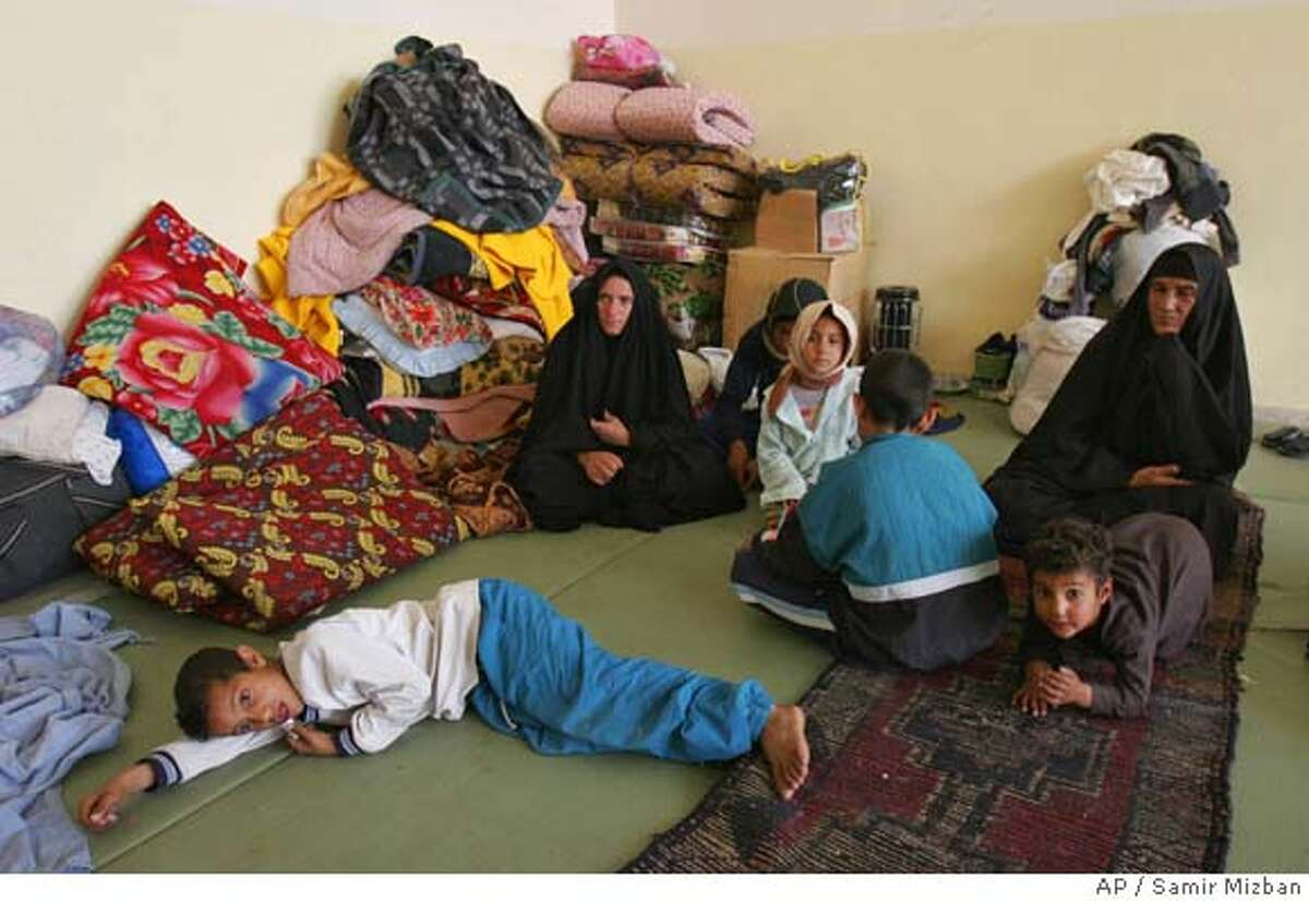 A displaced Iraqi Shiite family rests at a makeshift refugee camp, in Baghdad, Iraq, Wednesday, March 1, 2006. Many Iraqi Shiites Muslim families living in a Sunni dominated areas have fled and taken refuge in a safer places, fearing sectarian tensions on the rise, a dangerous precursor to civil war in Iraq. (AP Photo/Samir Mizban) ** TO GO WITH STORY SLUGGED IRAQ THREATENED SHIITES BY BUSHRA JUHI **
