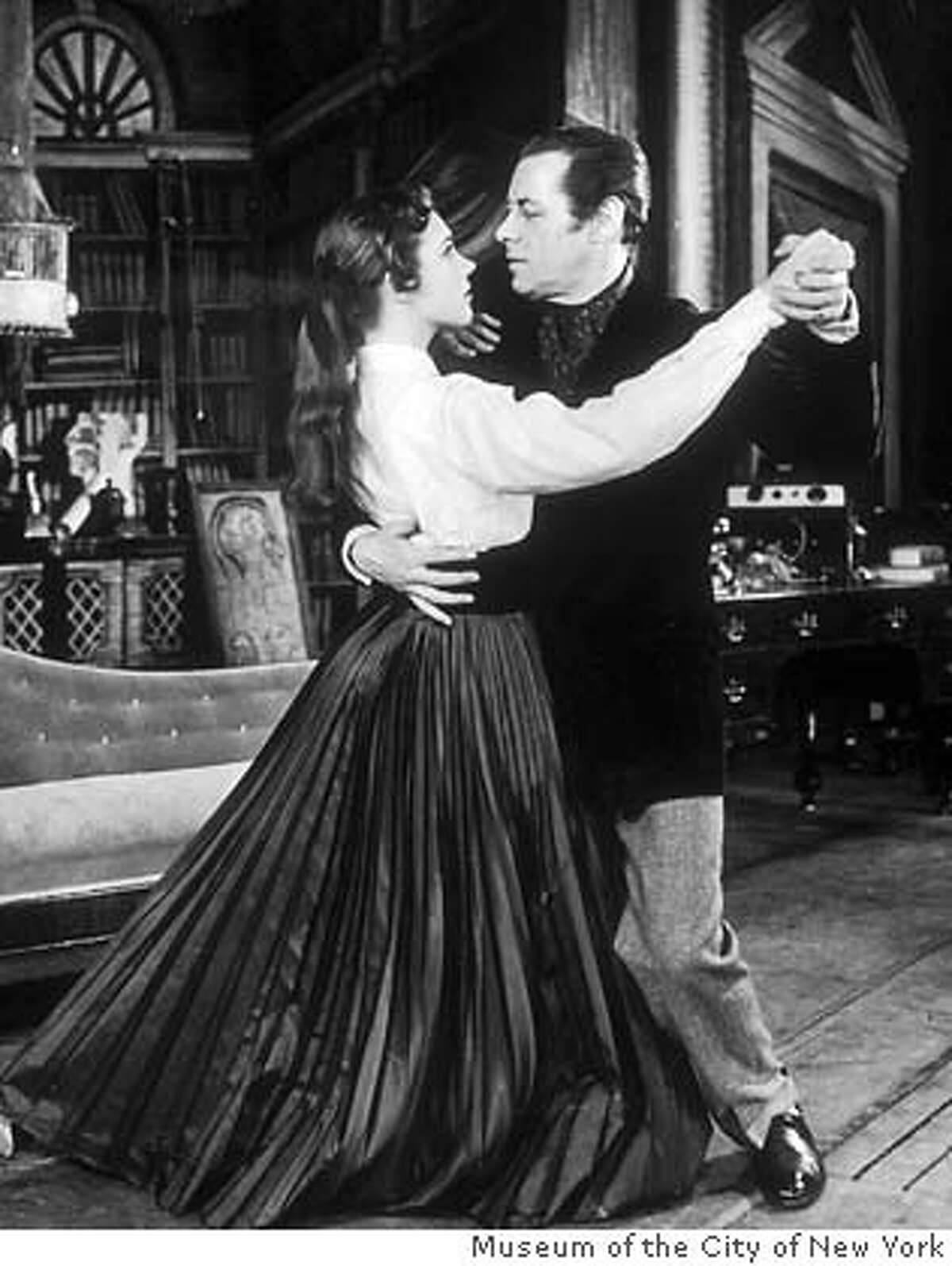 circa 1955: Full-length image of British actors Rex Harrison and Julie Andrews dancing together in a scene from the Broadway musical, 'My Fair Lady,' Mark Hellinger Theatre, New York City. (Photo by Museum of the City of New York)Ran on: 03-12-2006