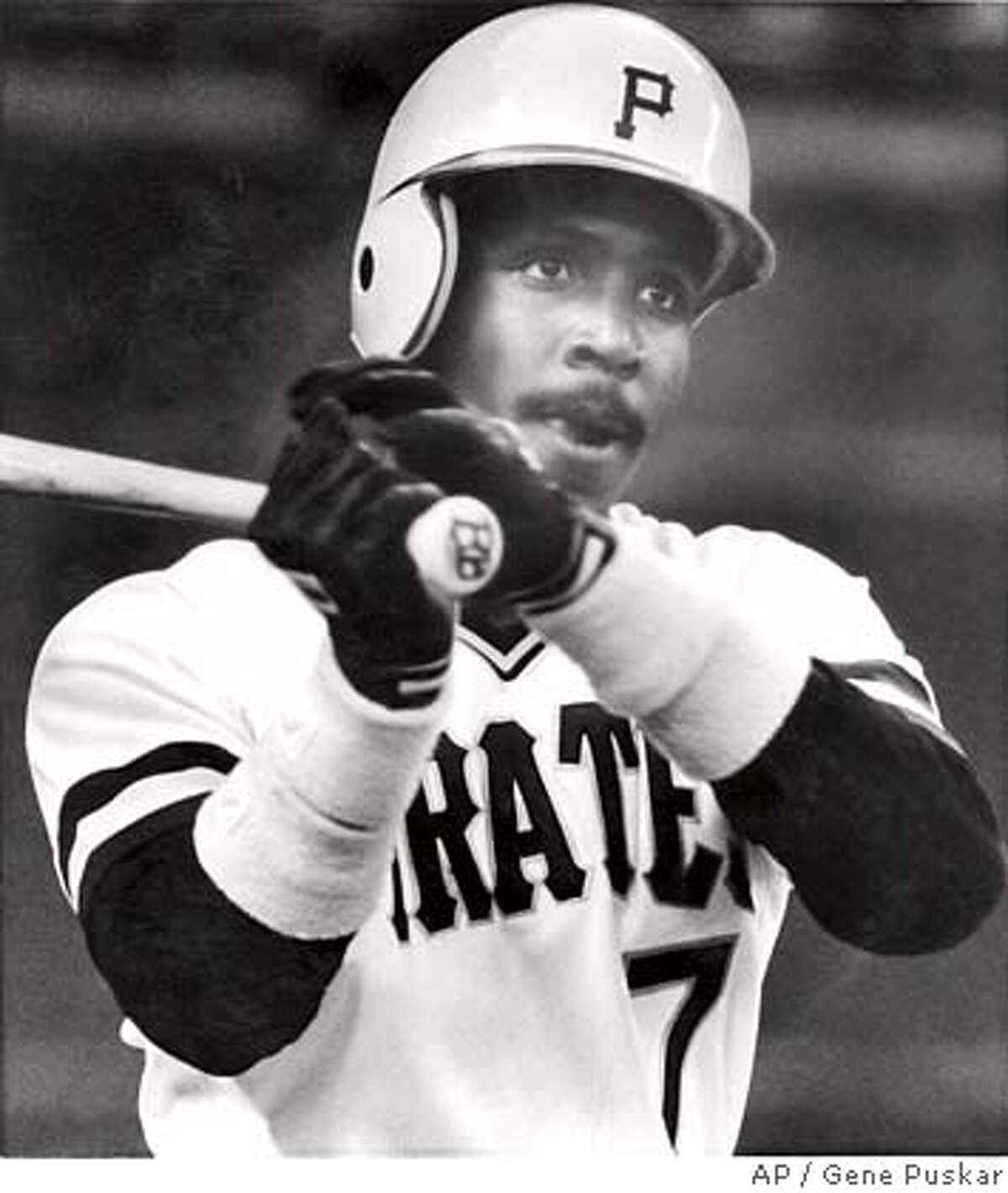 Pittsburgh Pirates' Barry Bonds warms up on the deck circle before his first major league at-bat during the first inning of play against the Los Angeles Dodgers in Pittsburgh, May 30, 1986. (AP Photo/Gene Puskar)