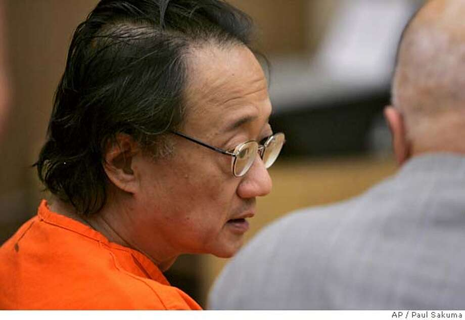 Norman Hsu, 56, left, talks with his attorney James Brosnahan, right, in a Redwood City, Calif., courtroom, Friday, Sept. 21, 2007. Democratic fundraiser Norman Hsu was ordered held without bail Friday, a day after being returned from Colorado on an outstanding warrant for his arrest in a grand theft case. (AP Photo/Paul Sakuma, pool) POOL PHOTO Photo: Paul Sakuma