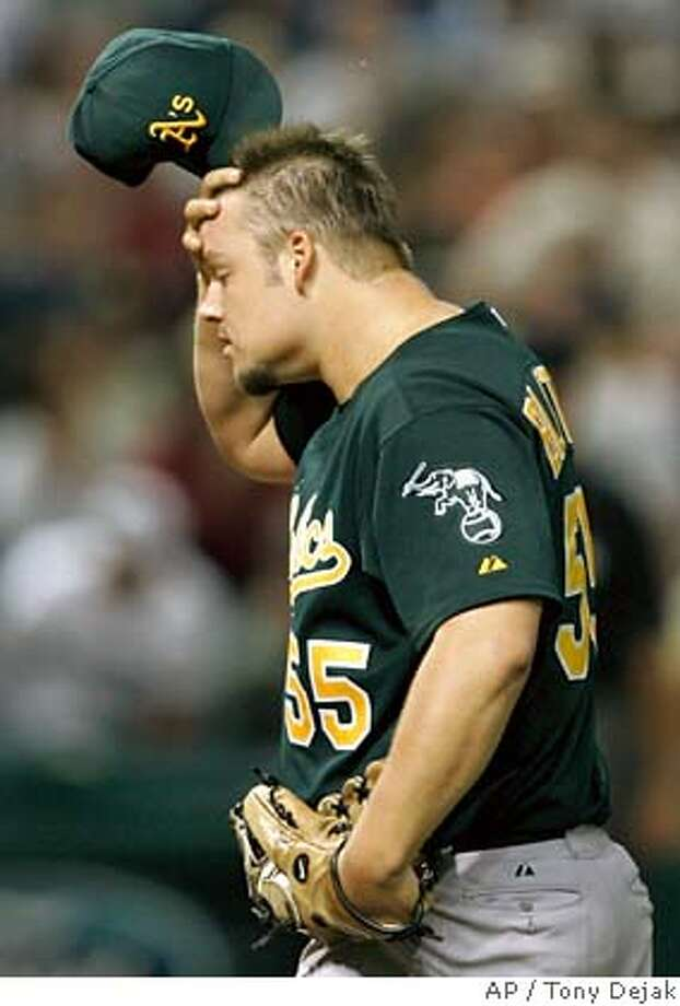 Oakland Athletics pitcher Joe Blanton wipes his forehead after giving up a single to Cleveland Indians' Kenny Lofton during the sixth inning of a baseball game Friday, Sept. 21, 2007, in Cleveland. Blanton also gave up two solo home runs in the sixth inning. (AP Photo/Tony Dejak) Photo: Tony Dejak