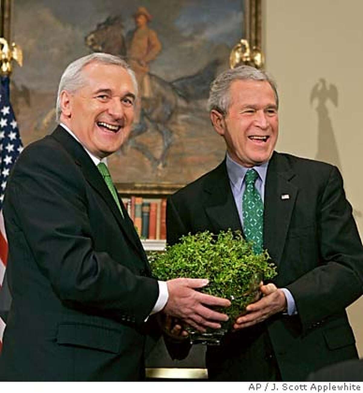 Ireland's Prime Minister Bertie Ahern, left, presents a bowl of shamrock to President Bush during a Saint Patrick's Day celebration in the Roosevelt Room of the White House in Washington, Thursday, March 17, 2005. (AP Photo/J. Scott Applewhite) Ran on: 03-18-2005 Irish Prime Minister Bertie Ahern (left) gives President Bush a bowl of shamrock to celebrate St. Patricks Day.