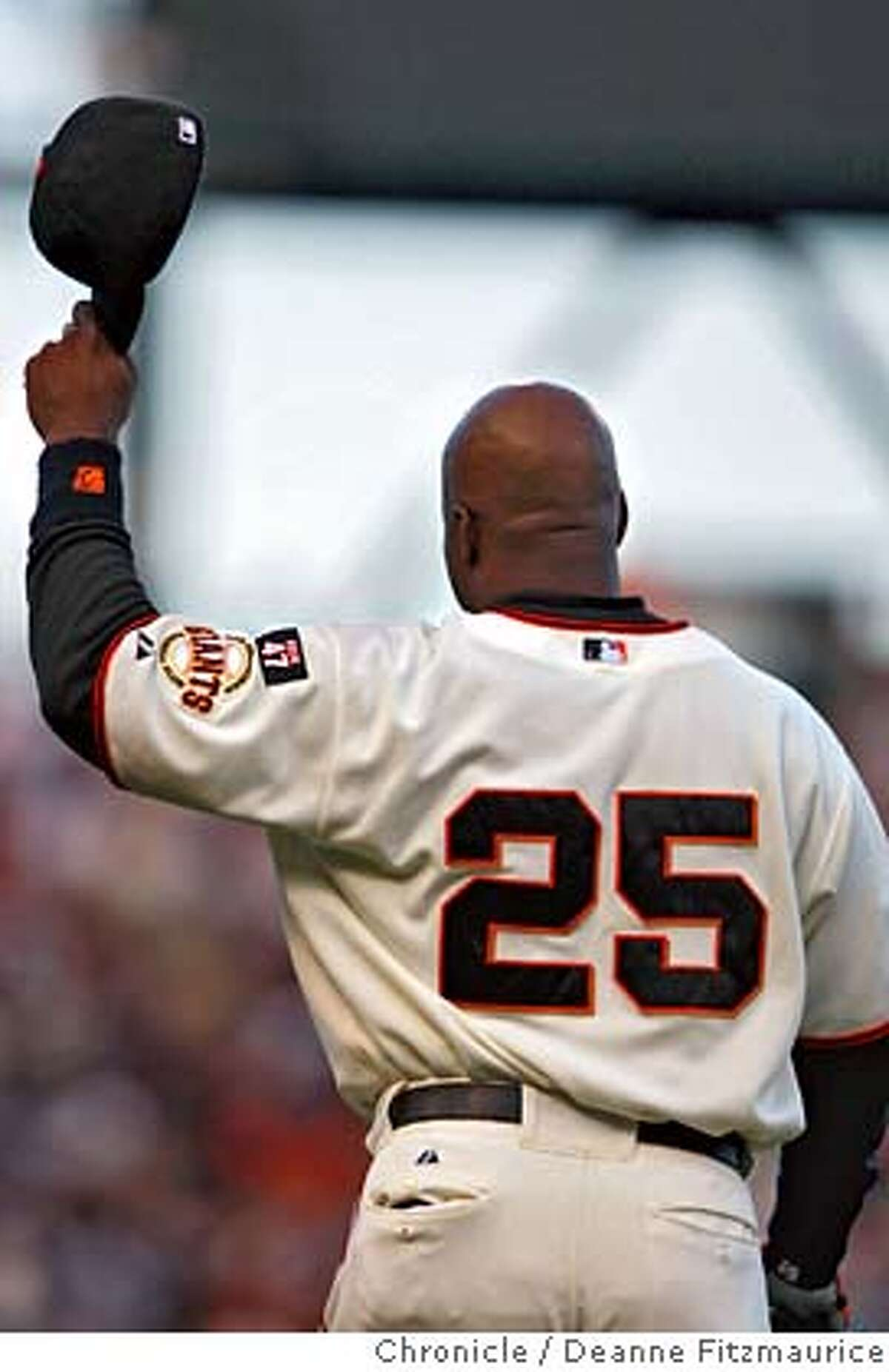 GIANTS28_df_009.JPG Barry Bonds tips his hat while taking the field in the top of the second inning after hitting home run number 754 in the bottom of the first inning off of Marlins starter Rick Vanden Hurk. Florida Marlins play the San Francisco Giants at AT&T Park in San Francisco, CA, on Friday, July, 27 2007. photo taken: 07/27/2007 Deanne Fitzmaurice / The Chronicle ** (cq) MANDATORY CREDIT FOR PHOTOG AND SF CHRONICLE/NO SALES-MAGS OUT