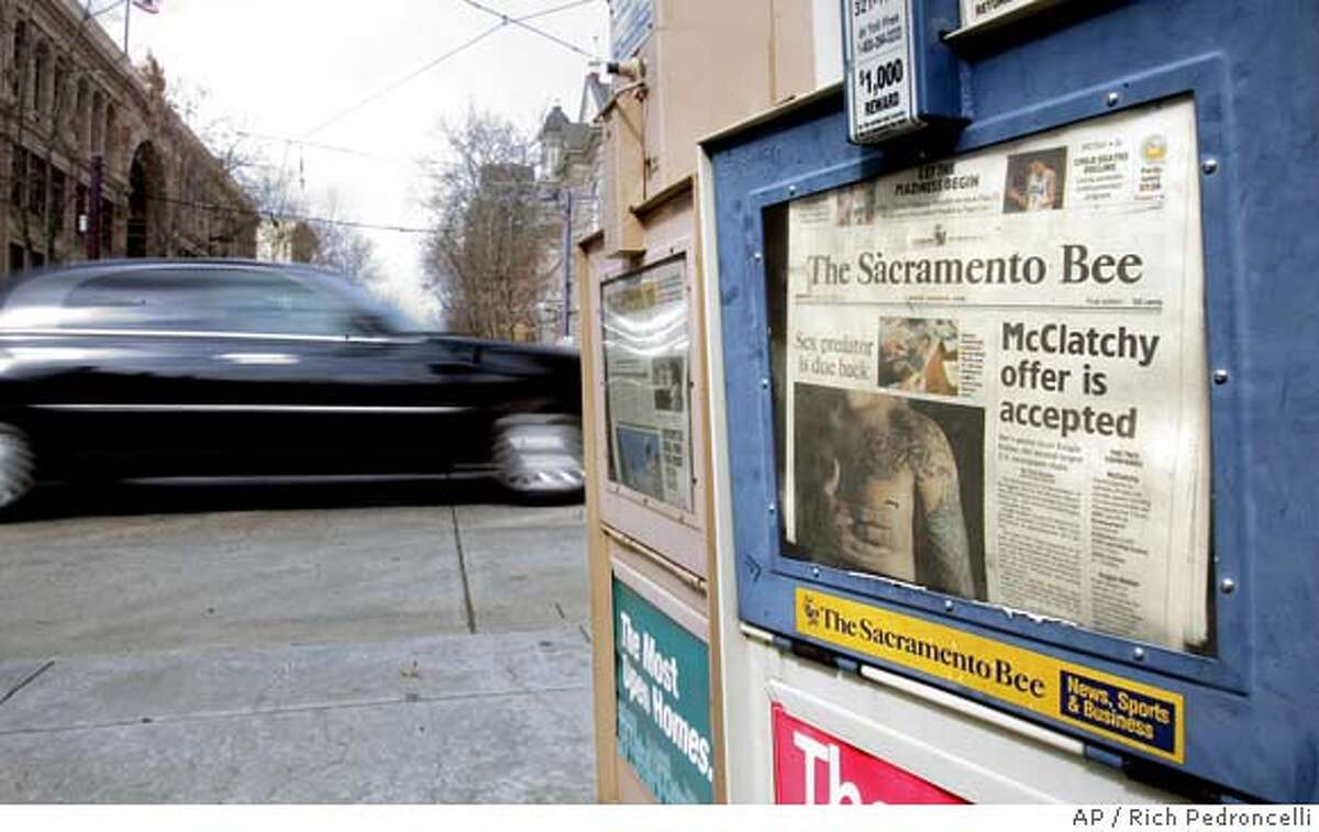 A headline announcing the purchase of Knight-Ridder by the McClatchy Co., is seen on the front page of McClatchy's flagship paper, The Sacramento Bee, in Sacramento, Monday, March 13, 2006. The purchase of Knight-Ridder Inc., for about $4.5 billion in cash and stock, will add several major newpapers to McClatchy's portfolio, including the Miami Herald, the Kansas City Star and the Fort Worth Star-Telegram. (AP Photo/Rich Pedroncelli)
